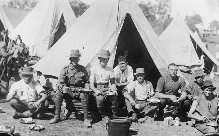 Sharing a meal at Fraser's Paddock, Enoggera Army Camp, Brisbane, ca. 1914.